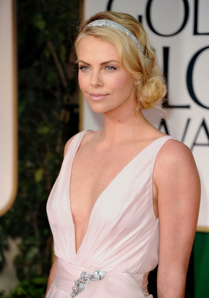 charlize theron side chignon hair