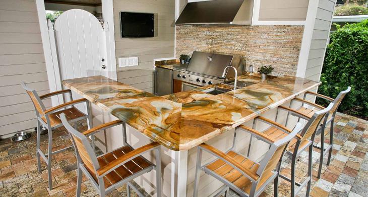 https://images.designtrends.com/wp-content/uploads/2016/07/26170611/Outdoor-kitchen-conuntertop-design-.jpg