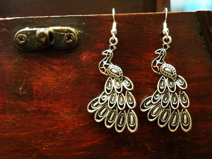 cool silver peacock earrings
