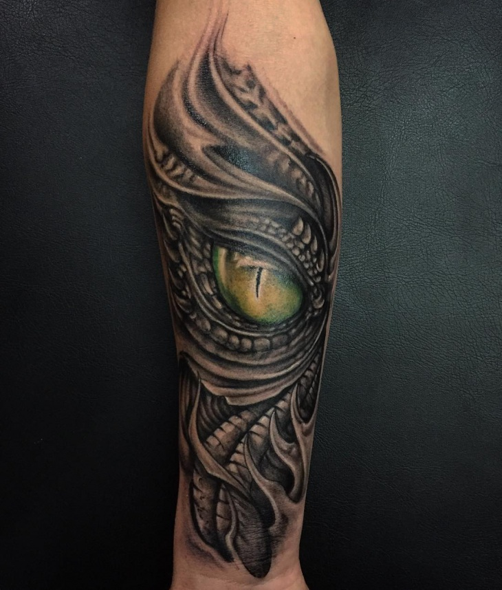 black and grey dragon eye tattoo