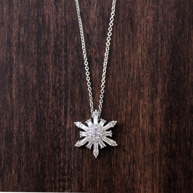 silver and diamond snowflake pendant