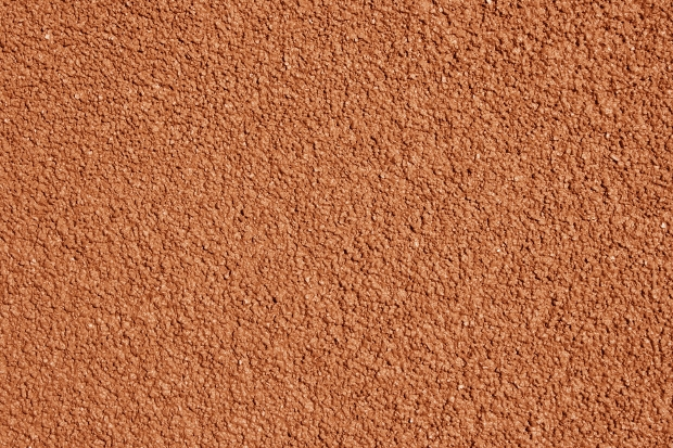 red stucco close up texture