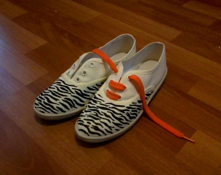 orange and white zebra print sneakers