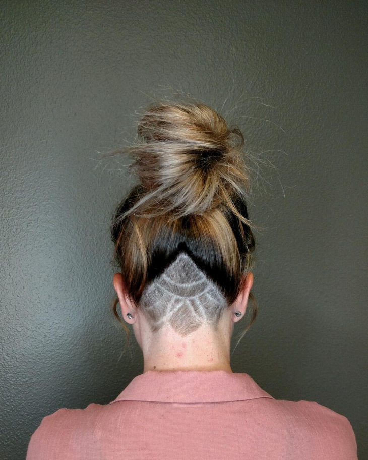 undercut designed updo hairstyle