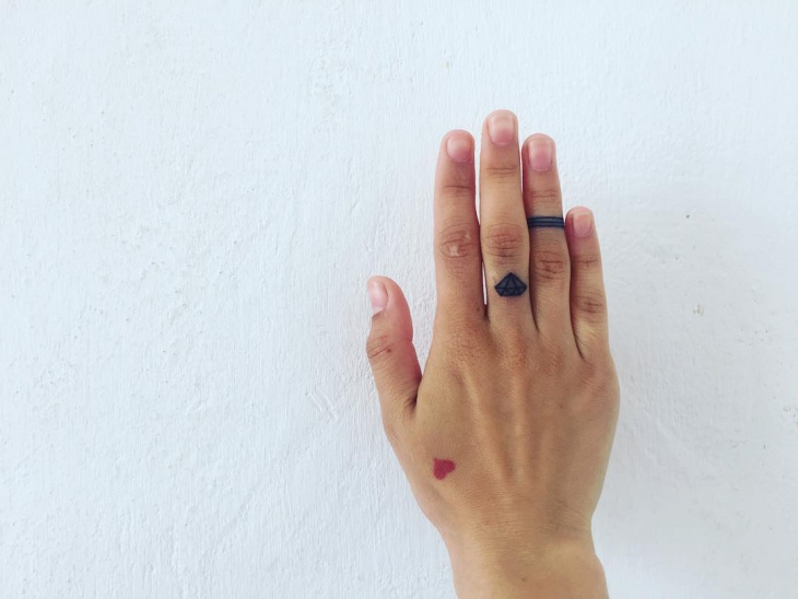 gem finger tattoo design