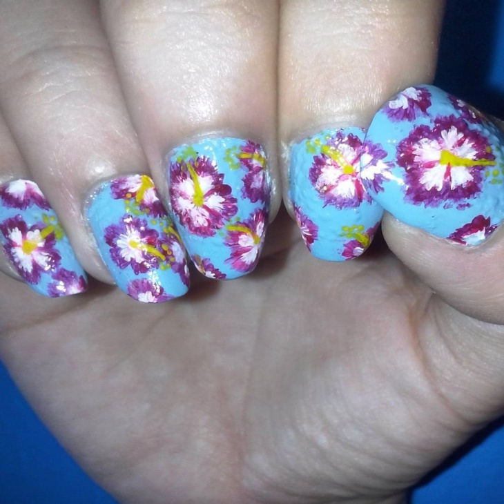 blue painted hibiscus nails