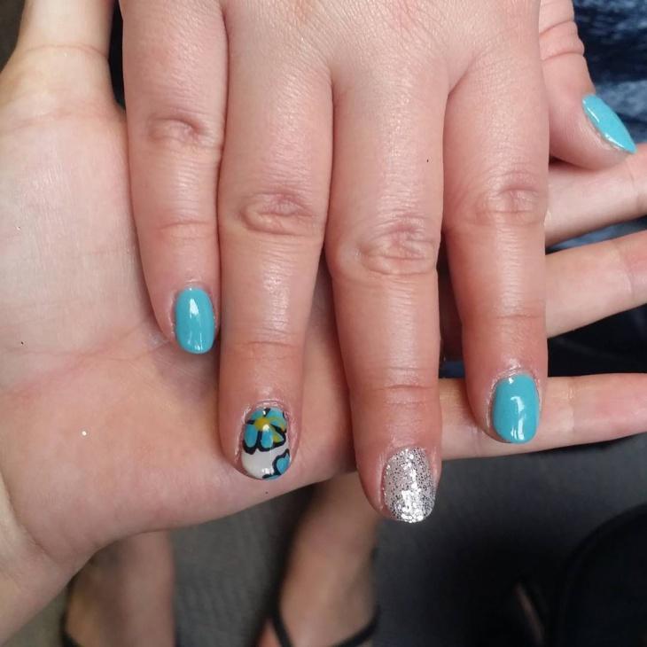 Teal Hibiscus Nail Art