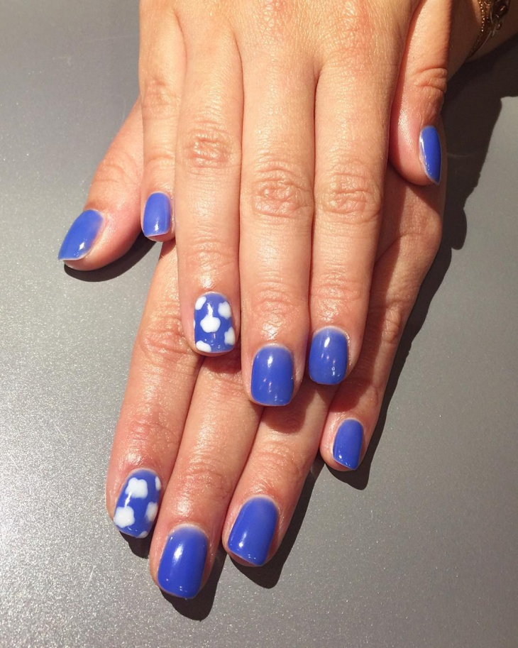 bright blue cloud nail art
