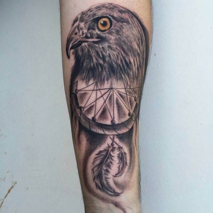 unique hawk tattoo on forearm