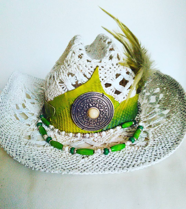 green and white feather hat