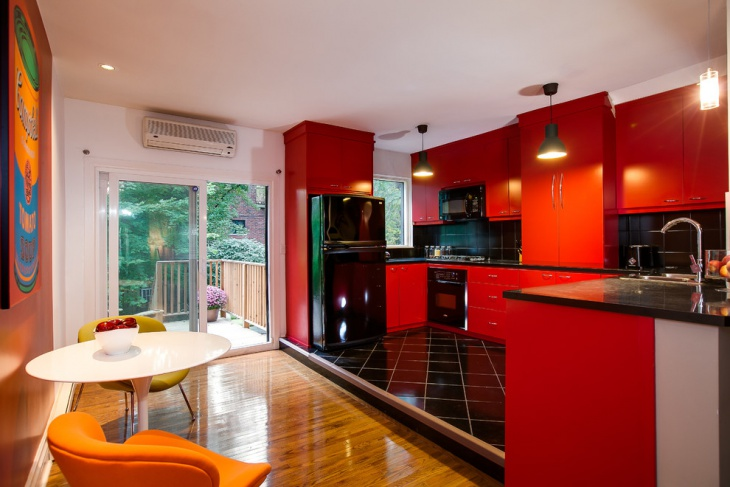 black flooring red kitchen cabinet idea