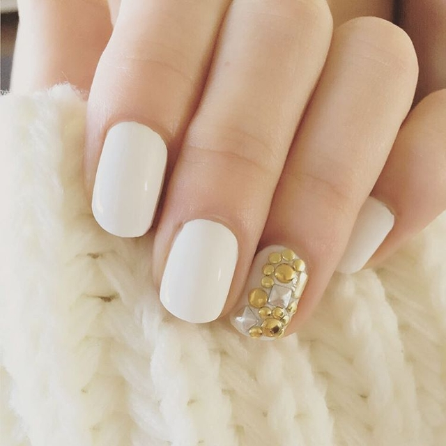white beaded nail design