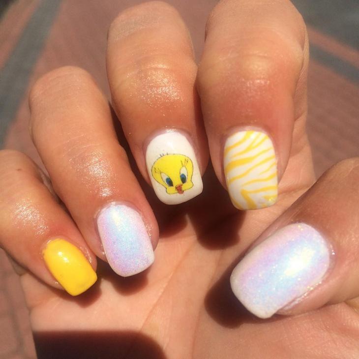 yellow and white glitter nail art