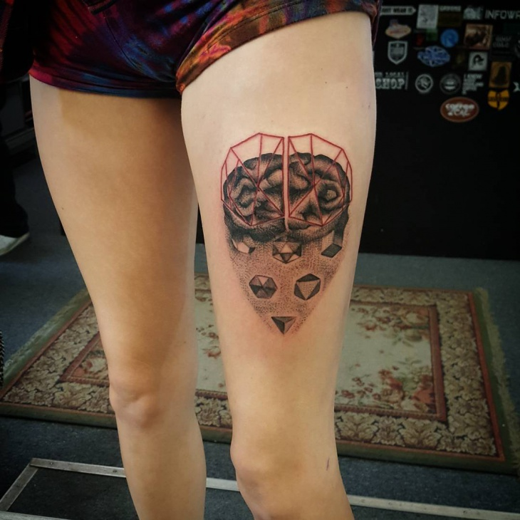 brain tattoo design on thigh