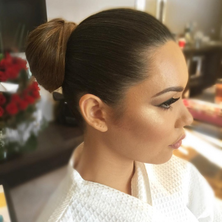 slicked back bun hairstyle for women