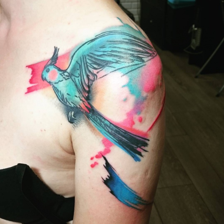 flying parrot tattoo