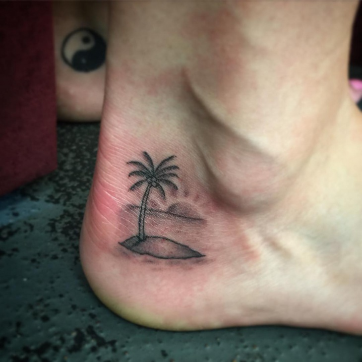 small palm tree ankle tattoo