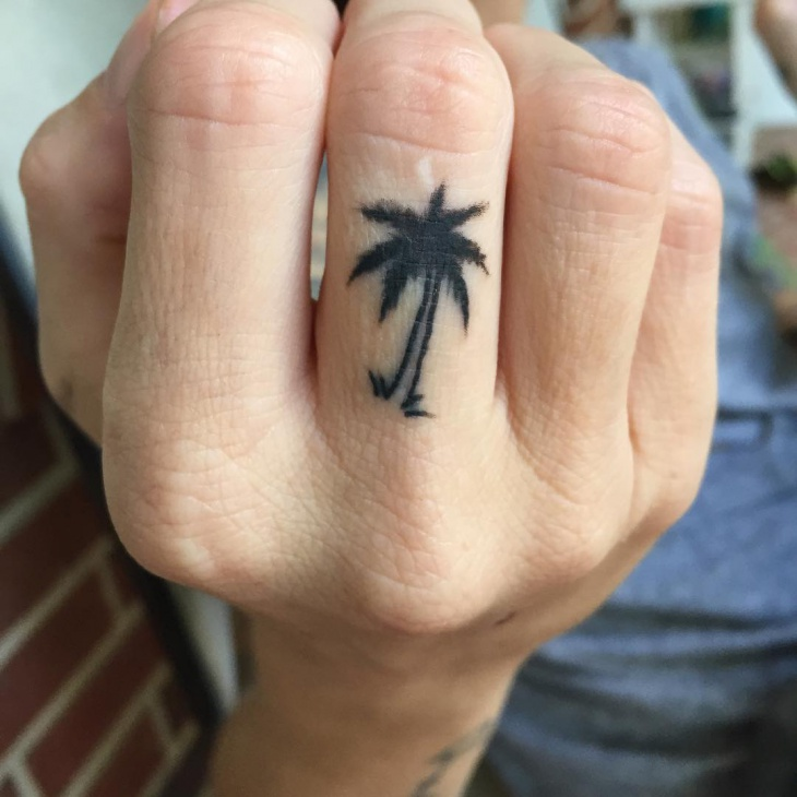 palm tree tattoo on finger