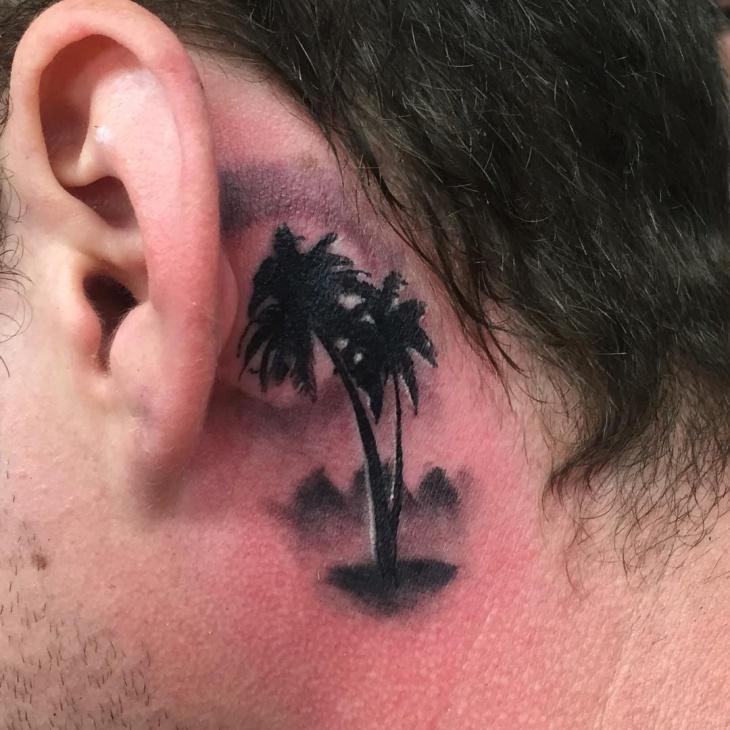 palm tree tattoo behind ear