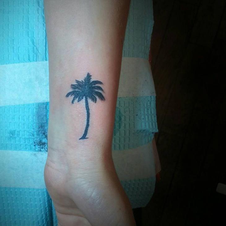 wrist palm tree tattoo