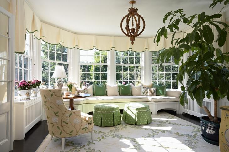 sunroom with flooring carpet
