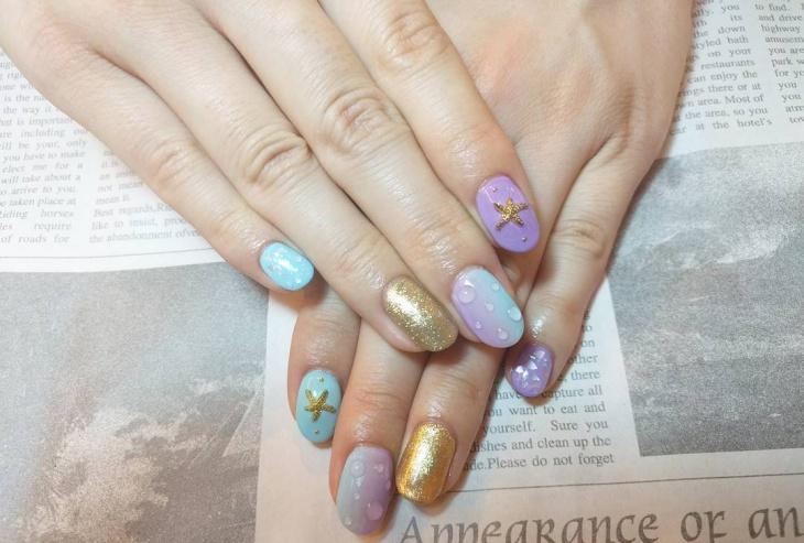 gold glitter water drop nails