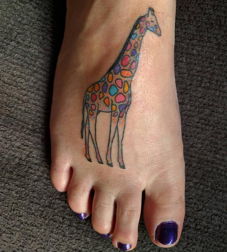 candy giraffi tattoo on foot