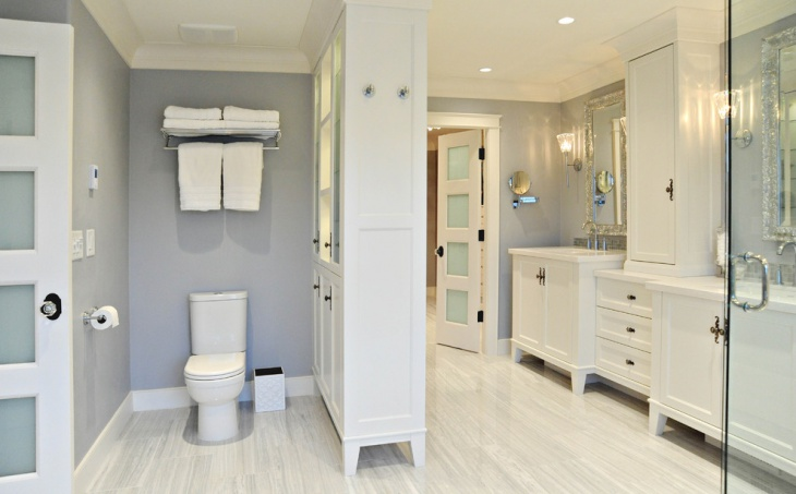 white bathroom with sink base cabinet