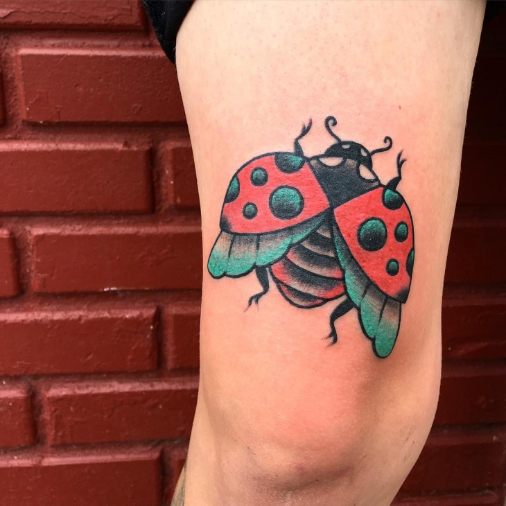large ladybug tattoo on arm