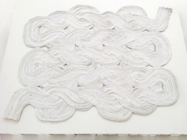 Discarded textile used to create stylish floor rugs