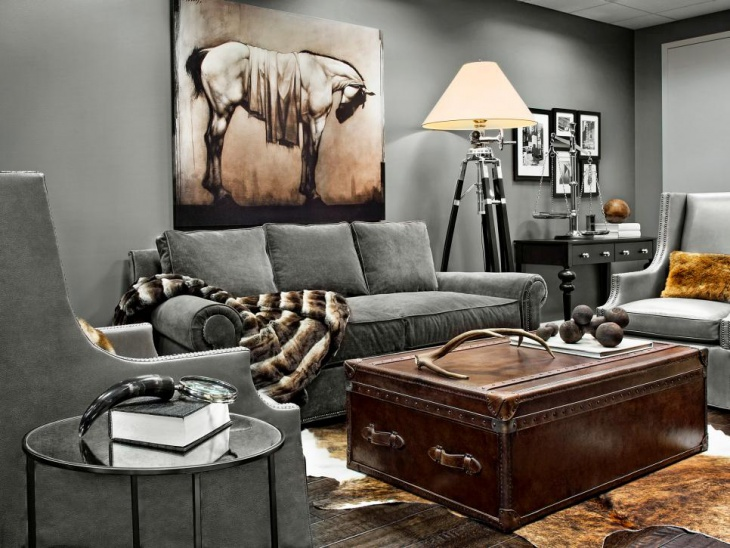 gray masculine living room with wall art