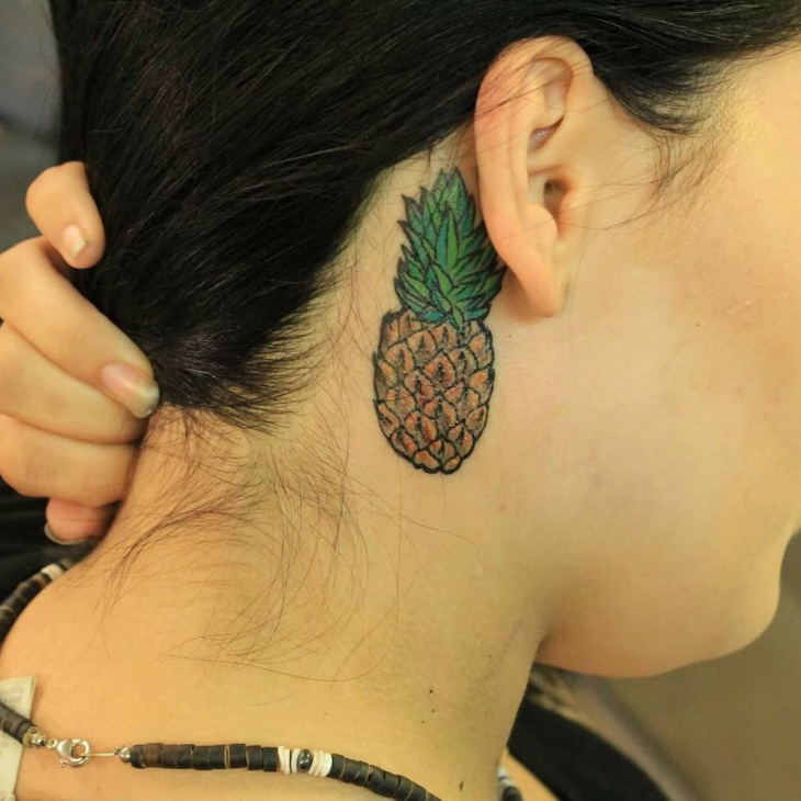 pineapple tattoo behind ear