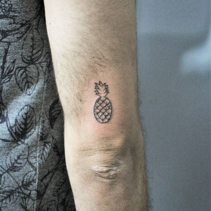 pineapple tattoo on elbow