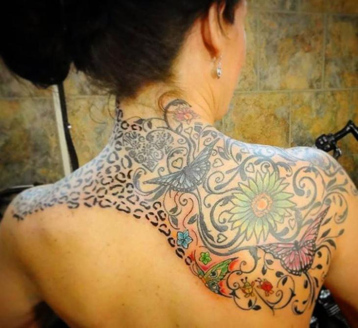 cheetah print back tattoo for women
