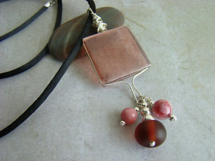 glass with rhodonite pendant
