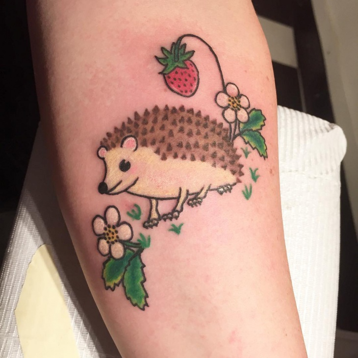 adorable hedgehog tattoo
