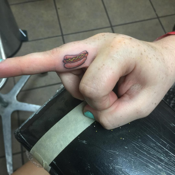 Small Hot dog Tattoo on Finger