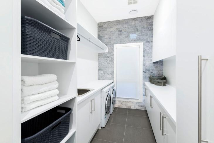 narrow white laundry room design
