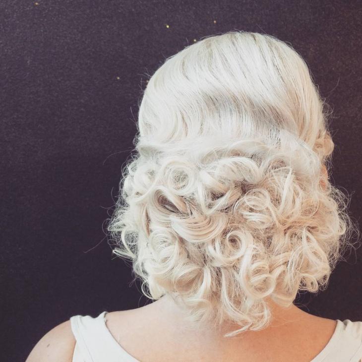 bride bun curly hair