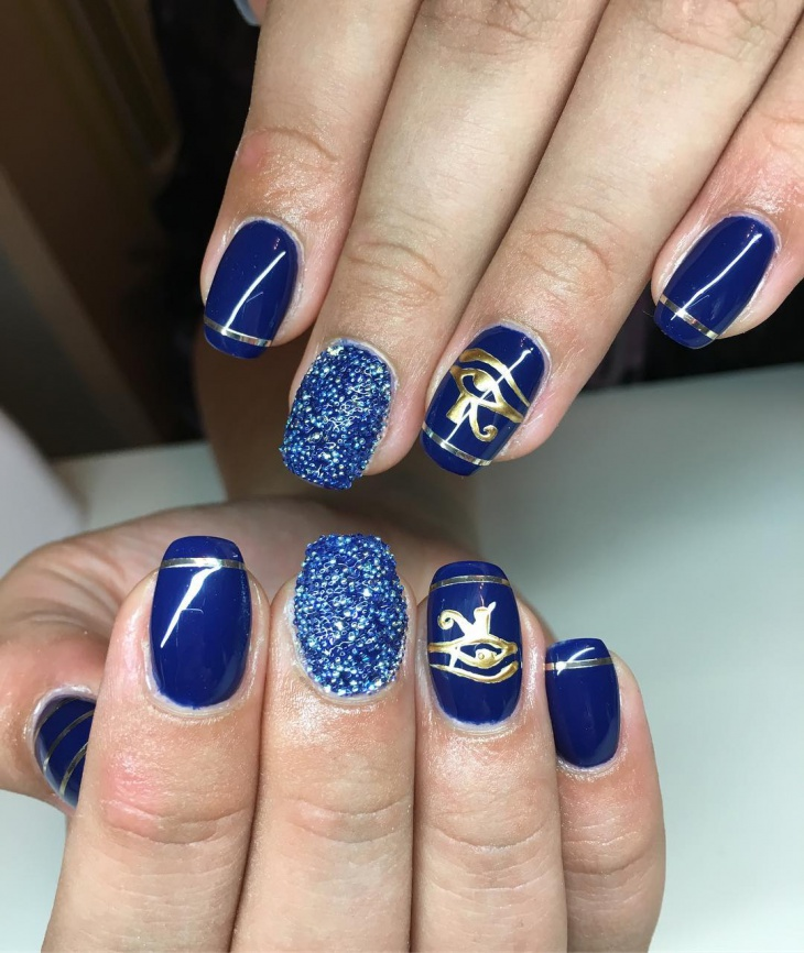 gold and blue nail art