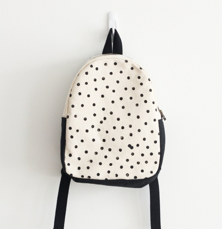 black and white polka dot backpack
