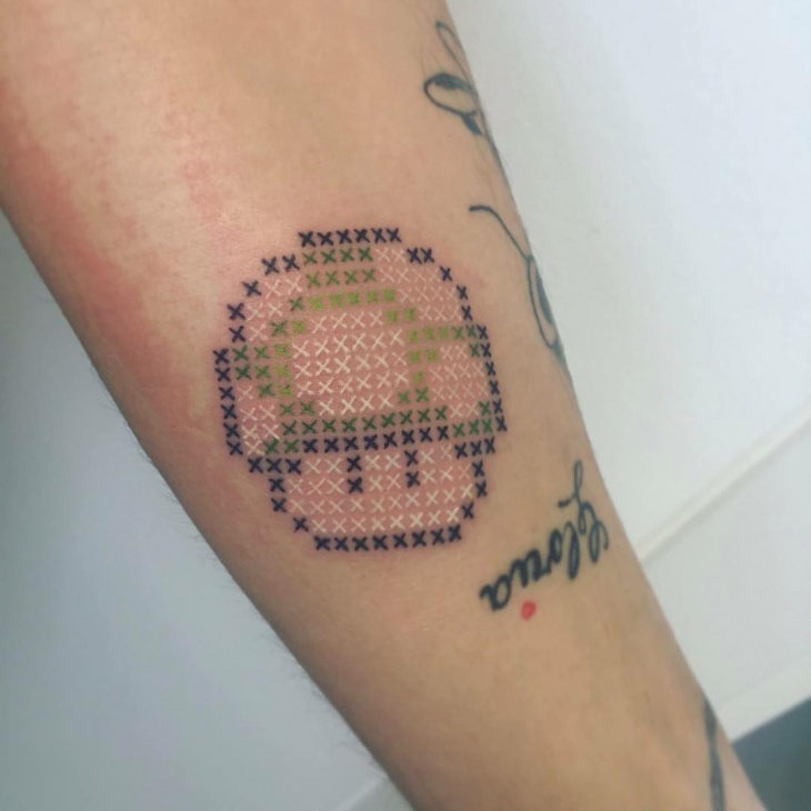 cool cross stitch tattoo