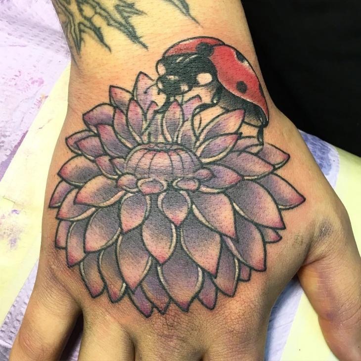 dahlia tattoo on palm