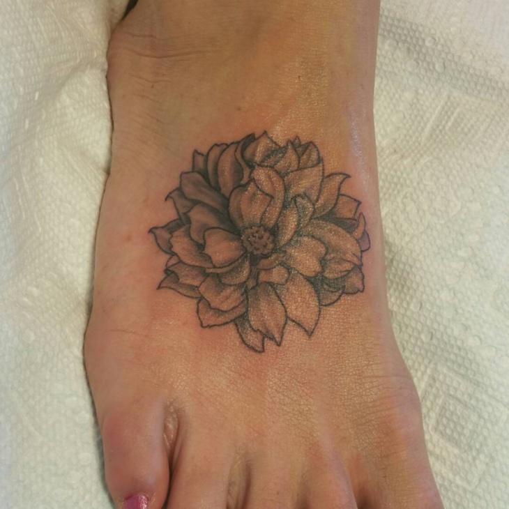 small dahlia foot tattoo