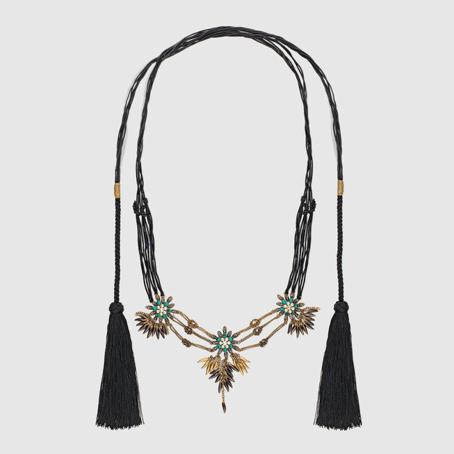 6. Cord Necklace with Metal Flowers- $ 1,700