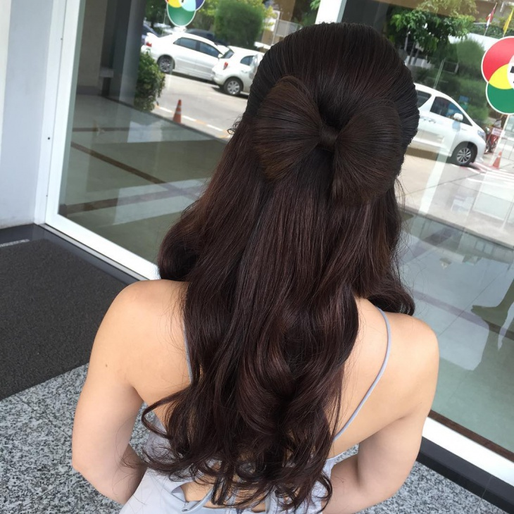 half updo bow hairstyle