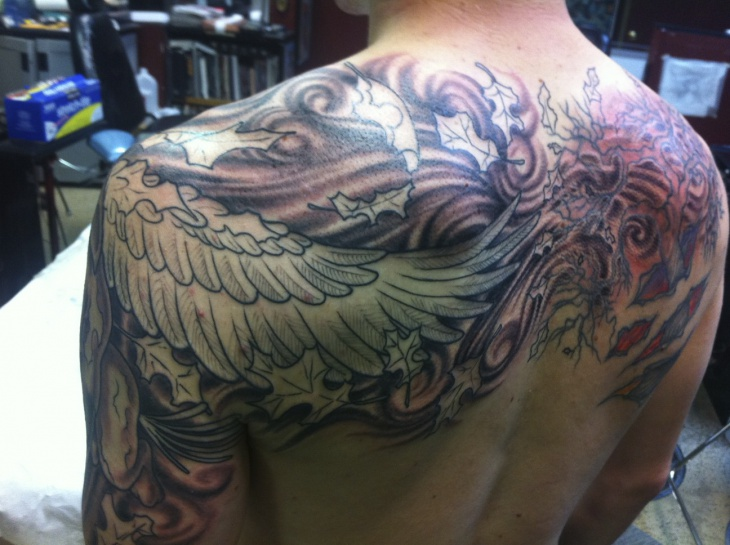 griffine tattoo with wings