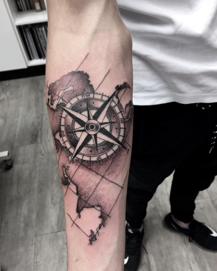 world map tattoo on forearm