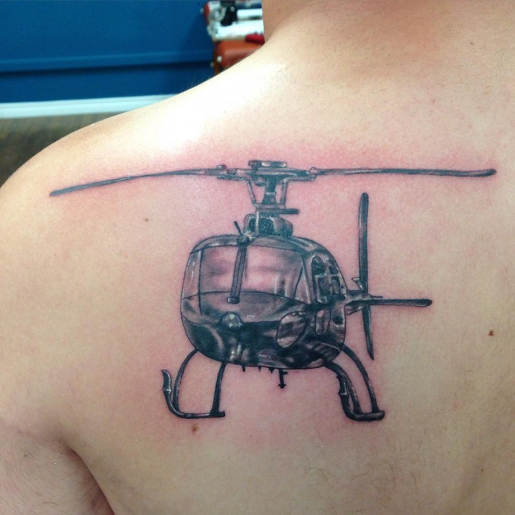 black and gray helicopter tattoo