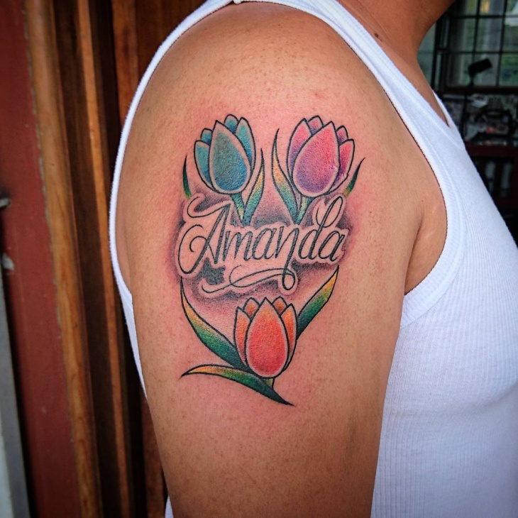 tulip flower tattoo on shoulder